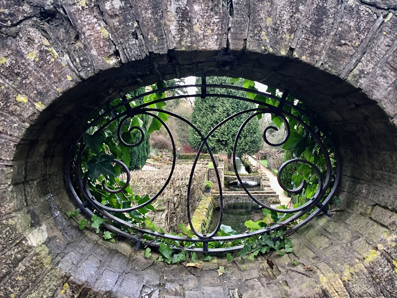 """Private gardens through a """"window"""" in a wall in Nagshead !"""