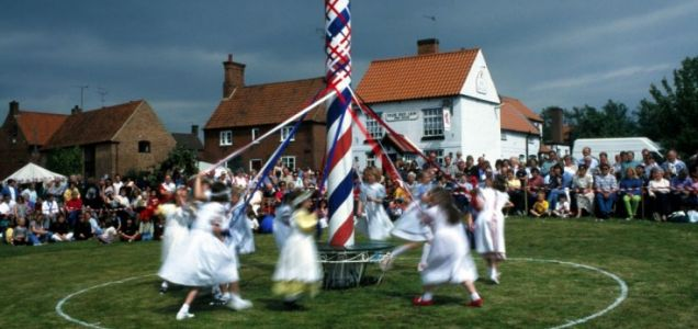 Children dancing around the Maypole - one of the innocent traditions of Mayday